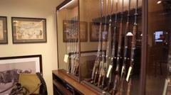 Row of shotguns on display in store Stock Footage