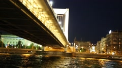 View coming out from under Margaret Bridge at night Stock Footage