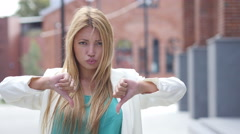 Thumbs Down for Failure by Beautiful Blonde Girl, Outdoor Portrait Stock Footage
