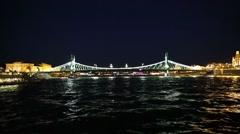 Chain Bridge's lights glowing through the night's sky Stock Footage