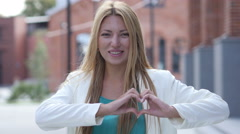 Heart Shape by Hand, Made by Beautiful Girl Stock Footage