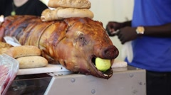 Stuffed roasted pig for sale at local meat market Stock Footage