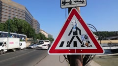 Road sign: pedestrians crossover here. Traffic driving by Stock Footage