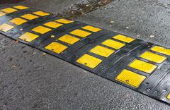 Traffic safety speed bump on an asphalt road Stock Photos