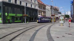 Bus riding along tracks down street of Bratislava Stock Footage
