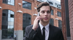 Wallking Businessman Talking on Phone, Negotiation Stock Footage