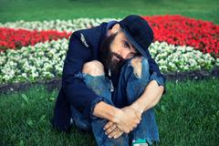 Vagrant in flowerbed Stock Photos