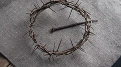 Rotation on crown of thorns and large nail on burlap. Stock Footage
