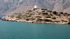 Old windmill on the hill in the Mediterranean coast aerial video Stock Footage