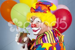 Tipsy Clown Sneaks a Drink Stock Photos