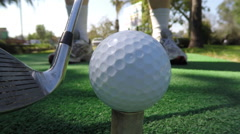 Macro of Golf Ball Being Hit Off Tee Stock Footage