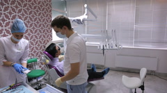 Doctors prepare for teeth treatment in working cabinet Stock Footage