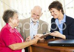 Senior Financial Advice - Sign Here Stock Photos