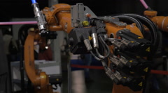 On exhibition Robotix expo seen robots which fight with light swords Stock Footage