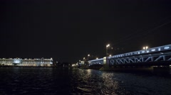View of bridge above river in night in city. Lights. Tourist boat. Timelapse Stock Footage