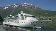 Cruise ship with snowy mountains background - Norway Stock Footage