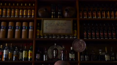 Lots of rum on the shelves of Cuban bar in Havana. Stock Footage