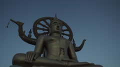 Big statue of Buddha on sunrise. Blue sky, Indian culture. Religion. Timelapse Stock Footage