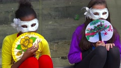 Children dress in Mardi Gras style masks on the streets of Havana, Cuba. Stock Footage