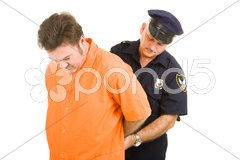 Prisoner and Police Officer Stock Photos