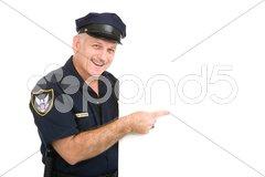 Happy Policeman Pointing Stock Photos