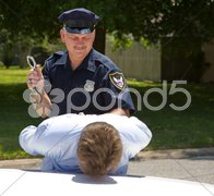 Police Officer with Handcuffs Stock Photos