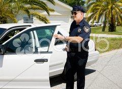 Police - Exiting Police Car Stock Photos