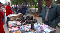 Vendors on the streets of Havana, Cuba sell old cameras, radios and propaganda Stock Footage