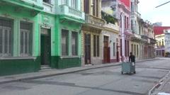 A street vendor walks down a boulevard in Havana Cuba selling his wares. Stock Footage
