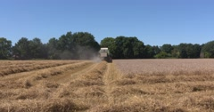 Combine harvester in field - off camera Stock Footage