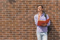 Thoughtful male student learning subject Stock Photos