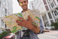 Joyful male tourist planning his journey Stock Photos