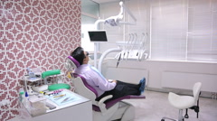 Dental unit in cabinet, with a man lying on her patients, interior of dental Stock Footage