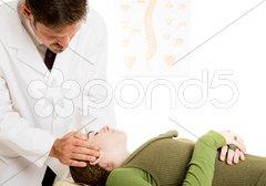 Chiropractor - Gentle Neck Adjustment Stock Photos