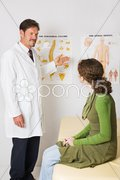Chiropractor Explains Spinal Column Stock Photos