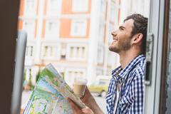 Happy traveler dreaming of journey Stock Photos