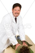 Friendly Chiropractor Gives Adjustment Stock Photos