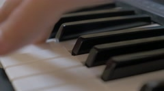 Gliding from one pitch to another on piano keys close-up 4K 2160p 30fps Ultra Stock Footage
