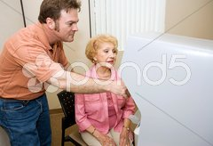 Poll Worker Assists Sr. Voter Stock Photos