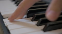 Slow-mo gliding from one pitch to another on piano keys close-up Stock Footage