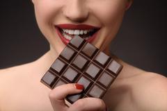 Joyful girl enjoying sweet food Stock Photos