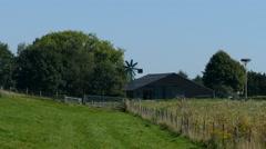 Farm with windmill in Dutch landscape Stock Footage