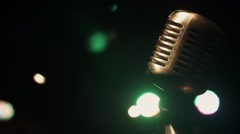 Concert metal gleam microphone stay on stage in retro club. Green spotlights Stock Footage
