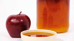 Red apple and jar of honey and bowl of honey isolated on a white background Stock Footage