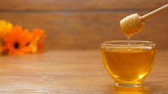 Honey in a beautiful glass bowl. Honeyspoon dipped in honey (No 9.4) Stock Footage
