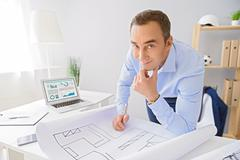 Adult businessman working in office Stock Photos