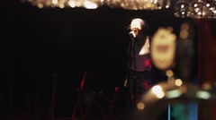 Scrubwoman stand up on stage, start sing in vintage microphone under spotlight Stock Footage