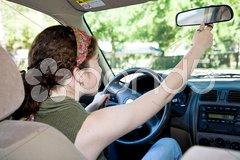 Teen Driver Adjusting Rearview Mirror Stock Photos