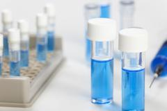 Close up of a vial containing a blue fluid Stock Photos