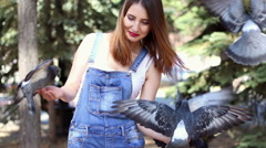 Woman holding a pigeon Stock Footage